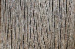 Vieille texture en bois de brun foncé abrégez le fond Images stock