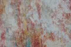Vieille texture grunge jaune bleue rouge de fond de mur de ciment Photo stock