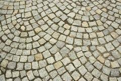 Vieille texture pavée en cailloutis de route Photos libres de droits