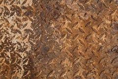 Vieille texture rouillée de plat de diamant en métal Images stock