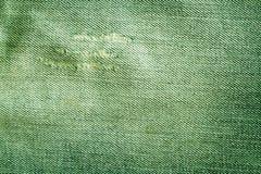 Vieille texture verte de jeans avec des éraflures Photographie stock