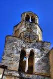 Vieille tour de cloche en pierre d'église Images libres de droits