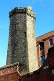Vieille tour médiévale de style au dock de Stanley Photographie stock libre de droits