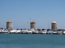 Vieille tour trois dans la photographie une de port de Mandraki Image stock
