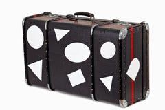 Vieille valise utilisée avec les collants blanc de course Photo libre de droits