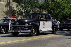 Vieille voiture de police dans le défilé grand de 73th semaine annuelle de Nisei Image libre de droits