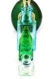 Vieilles bouteilles en verre d'isolement sur le fond blanc Photographie stock libre de droits