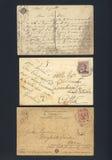 Vieilles cartes postales écrites souillées Photographie stock libre de droits