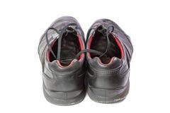 Vieilles chaussures avec des dentelles d'isolement sur le fond blanc Image stock