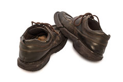 Vieilles chaussures - paires toujours de la vie des chaussures en cuir brunes vieilles et sales Images libres de droits