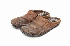 Vieilles chaussures sur le fond blanc. Image libre de droits