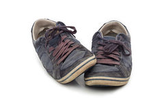 Vieilles chaussures utilisées d'isolement Photos stock