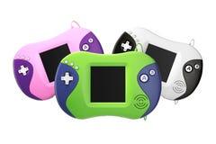 Vieilles consoles portatives multicolores de jeu vidéo rendu 3d Photos stock