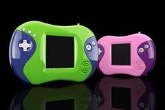 Vieilles consoles portatives multicolores de jeu vidéo rendu 3d Photo libre de droits