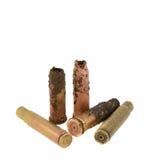 Vieilles douilles de fusil sur un fond blanc Images stock