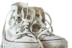 Vieilles espadrilles blanches sur le fond blanc Images libres de droits