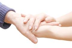 Vieilles et jeunes mains Image stock