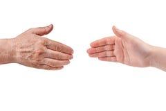 Vieilles et jeunes mains Photos stock