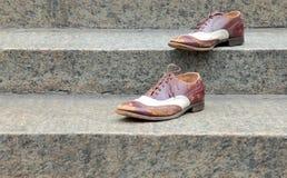 Chaussures sur les étapes Photographie stock