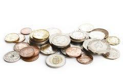 Vieilles pièces de monnaie sur le blanc Photographie stock libre de droits