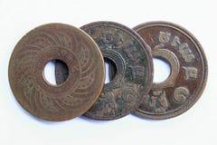 Vieilles pièces de monnaie thaïes Photographie stock