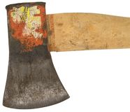 Vieja cabeza de hacha usada rústica con los remanente de una etiqueta fotografía de archivo