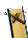 Vieja cruz y un libro Foto de archivo