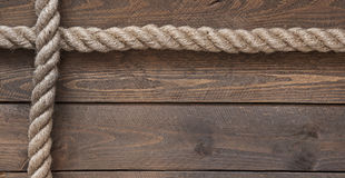 Vieja cuerda del vintage en la tabla de madera vieja Imagen de archivo