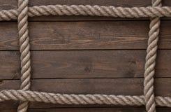 Vieja cuerda del vintage en la tabla de madera vieja Fotos de archivo