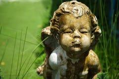 Vieja escultura del cupido Fotos de archivo libres de regalías