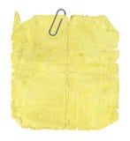 Vieja etiqueta engomada y clip de papel Imagen de archivo libre de regalías