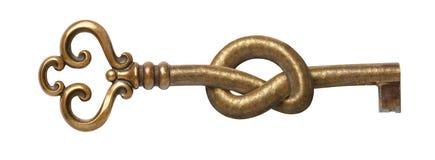 Vieja llave atada en el nudo El concepto de acceso cerrado, prohibición, contraseña secreta, protección contra cortar Aislado en  imagen de archivo libre de regalías