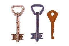 Vieja llave oxidada de la puerta aislada en blanco sistema dominante tres fotografía de archivo