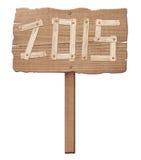 Vieja muestra de madera que muestra la dirección del movimiento Fotografía de archivo
