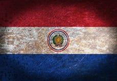 Vieja muestra oxidada del metal con una bandera Fotografía de archivo