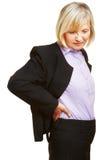 Vieja mujer de negocios que tiene dolor de espalda Imágenes de archivo libres de regalías