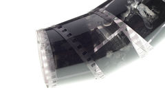 Vieja negativa tira de la película de 35 milímetros en el fondo blanco Imagen de archivo
