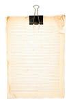 Vieja nota de papel y clip negro Fotografía de archivo