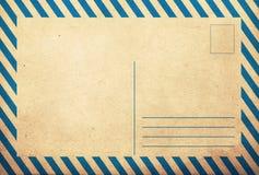 Vieja parte posterior de la postal del grunge del vintage Foto de archivo