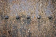 Vieja placa de metal con los remaches Foto de archivo