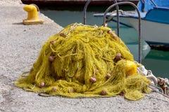 Vieja red de pesca con los flotadores Imagenes de archivo