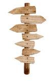 Vieja señal de tráfico de madera de la flecha aislada Imagen de archivo