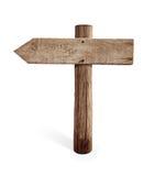 Vieja señal de tráfico de madera de la flecha izquierda aislada Foto de archivo libre de regalías