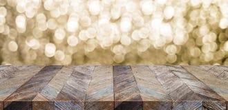 Vieja sobremesa de madera rústica vacía con el bokeh chispeante a del oro de la falta de definición Imagenes de archivo