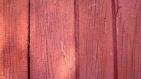 Vieja superficie de madera pintada roja para la textura del fondo almacen de metraje de vídeo
