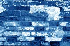 Vieja superficie sucia de la pared de ladrillo en tono de los azules marinos foto de archivo