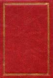 Vieja textura de cuero roja con el marco decorativo del oro Fotos de archivo libres de regalías