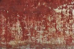 Vieja textura roja rasguñada y dañada de la pared Imagen de archivo