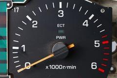 Vieja y sucia escena del indicador del tacómetro Fotografía de archivo libre de regalías