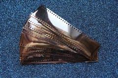 Viejas negativas en fondo azul Imagen de archivo libre de regalías